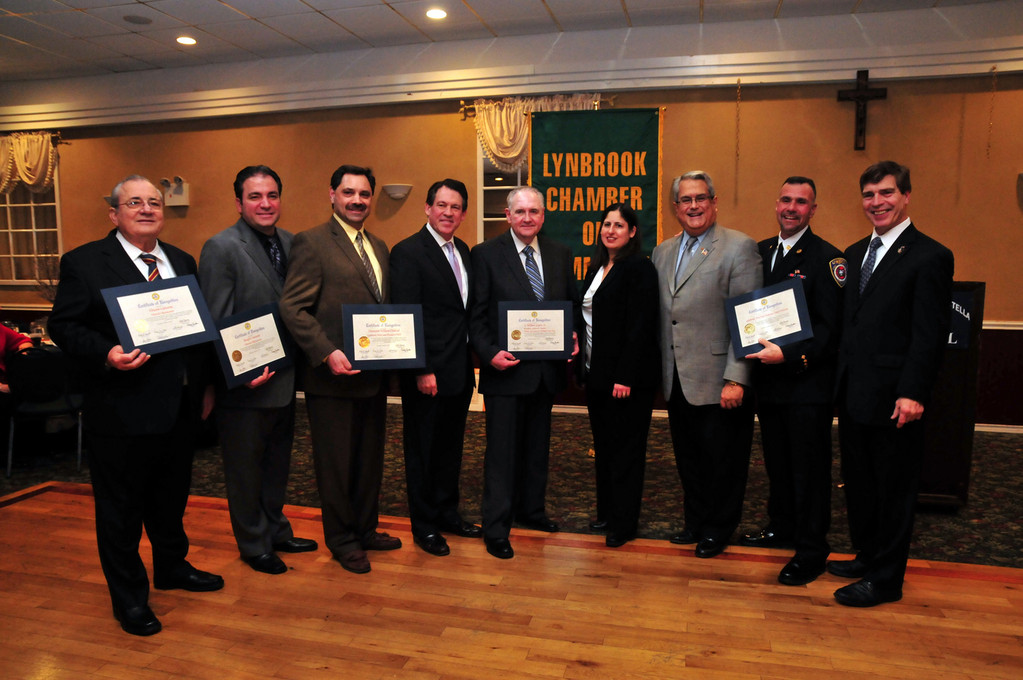 The Honorees accepted their awards from the Lynbrook Chamber. Pictured from left were honorees Vincent and Joseph Carusone, Sgt. Joseph Cipolla, accepting for awardee Det. William Diebold, who was unable to attend; Leg. Francis X. Becker, Honoree and outgoing Chamber president William Gaylor; new Chamber president Denise Rogers, Town of Hempstead Councilman Anthony Santino, honoree Chief Anthony �Zemo� DeCarlo, and Lynbrook�s Deputy Mayor Alan Beach.