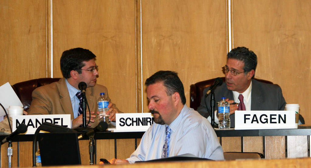 The meeting grew somewhat contentious when Councilman Mike Fagen, far right, inquired about public hearings.
