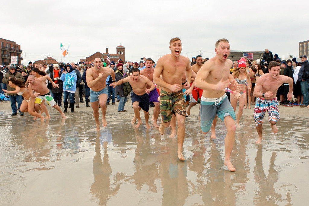 Participants darted into the water on Super Bowl Sunday.