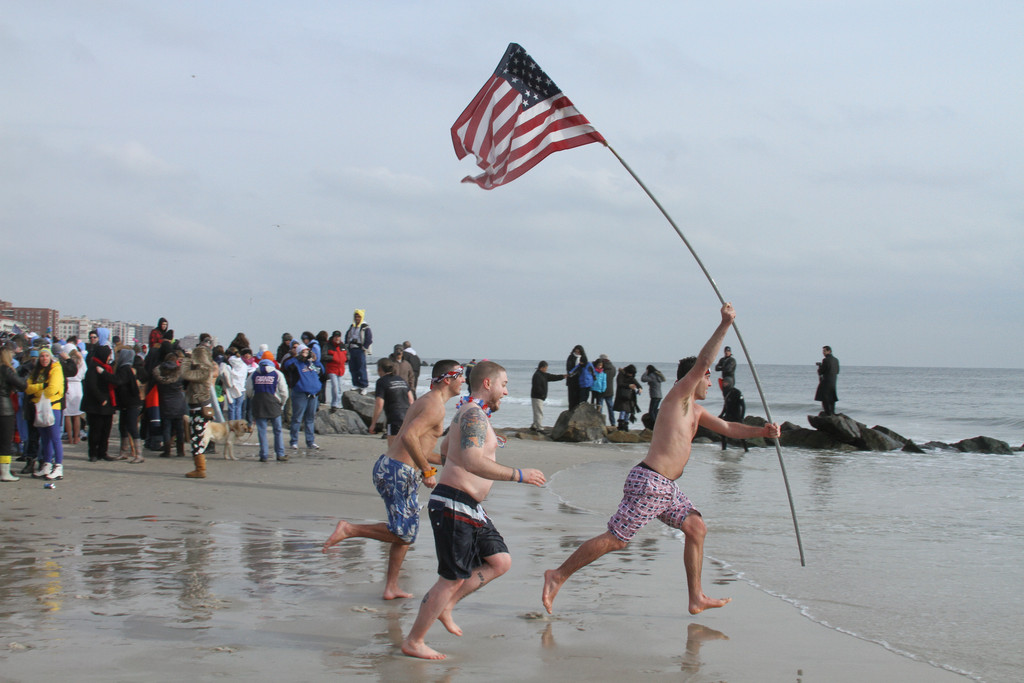 The 14th annual mass plunge in the Atlantic was still a resounding success, drawing a record crowd of about 20,000 and raising at least $500,000 for the Make-A-Wish Foundation.