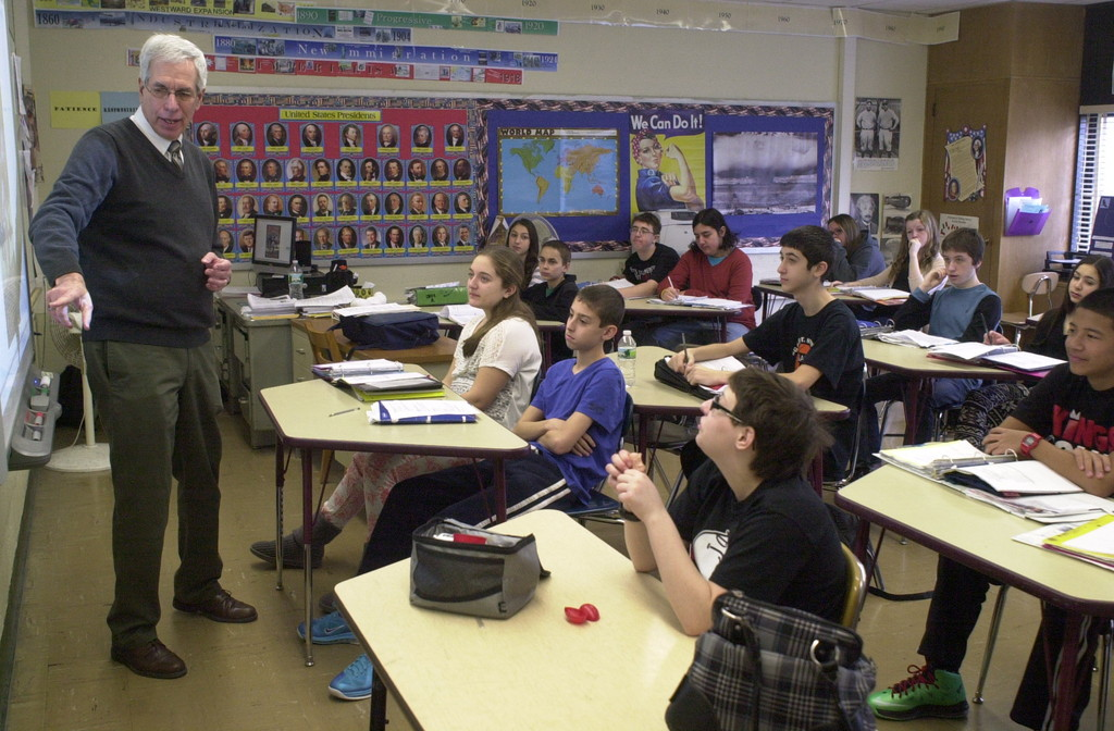 Dolber said he still loves teaching after four decades in the education field. Above, Dolber teaching a recent class on World War I to Merrick Avenue Middle School eighth-graders.
