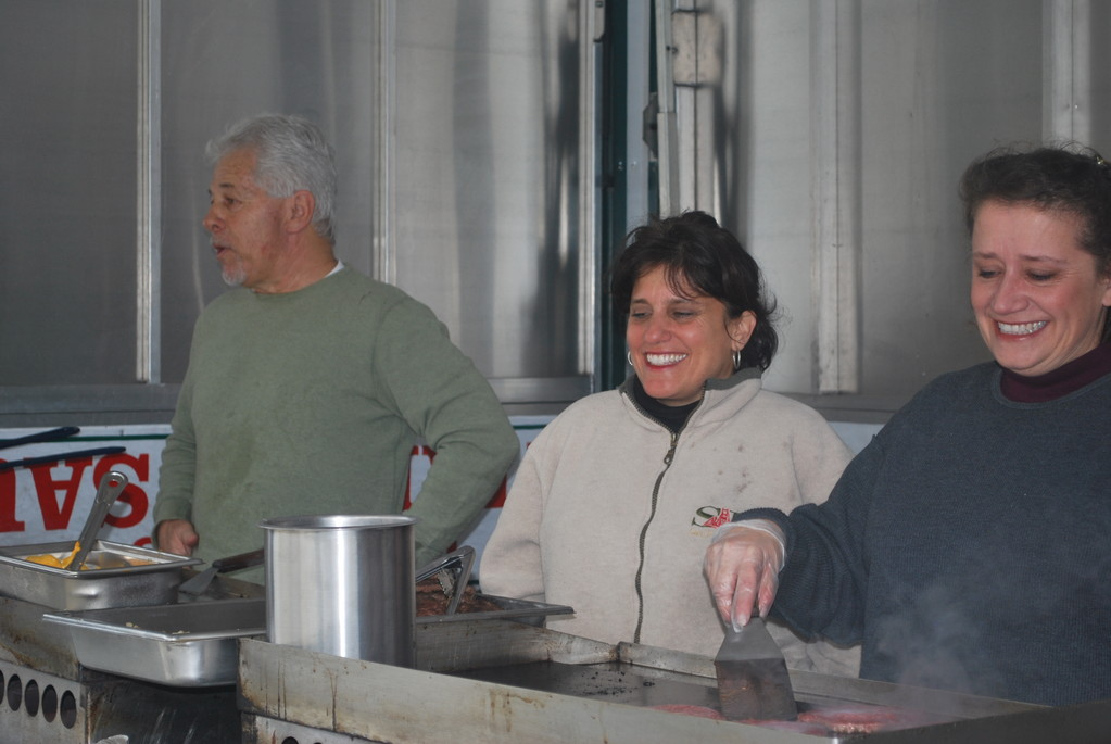 Famous Fasullo's, a Massapequa-based food service, is serving lunch to the high school students at the middle school. in the truck on Jan. 30 were, from left, Glenn Fasullo and his staff, Theresa Graziano and Mary-Jean Roamer.