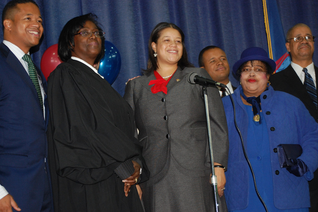 Assemblywoman Michaelle Solages, center, took the oath of office at a ceremonial inauguration at the Dutch Broadway School in Elmont last Friday. Joining her were, from left, her brother Carrié, Judge Michele Woodard, Solages�s brother Philippe Jr., and their parents, Micheline and Philippe.