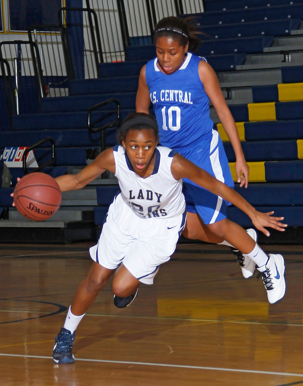 Baldwin's Tyra Harrison (17 points) avoided Valley Stream Central's Jasmine Garden during the first half of last Friday's Conference AA-II game.