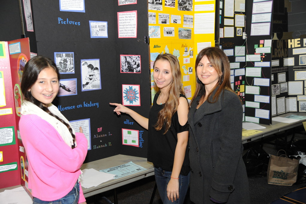 Middle school parents attended the Jan. 29 fair to see their children's projects. At right, Elaine Prusack visited with daughter Hannah Prusack, and Polio Vaccine project partner Alanna Landis.