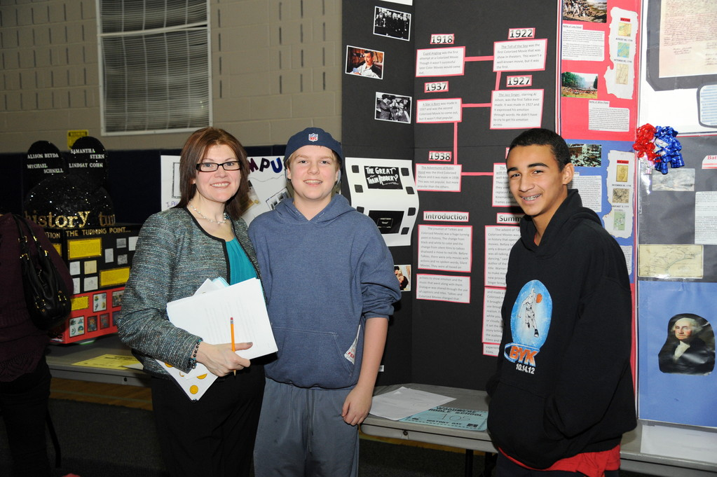 History Fair advisor Kathleen Durney judged the Life is Not Just Black and White project of Ryan Young, center, and Daniel Hilosberg.