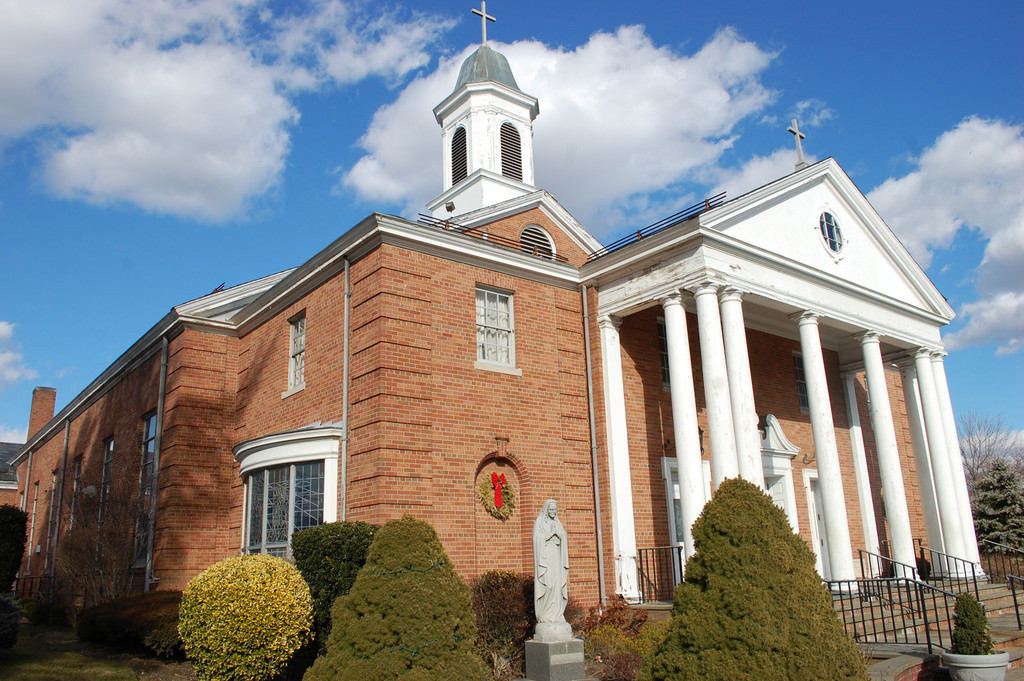 A parish renovation campaign would fund repairs of the front of the Blessed Sacrament Church, where the wooden overhang and columns are rotting, along with other projects.