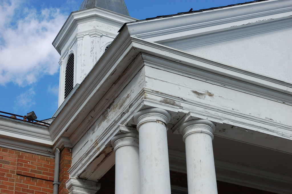 A close-up of the damaged overhang and columns at Blessed Sacrament Church.