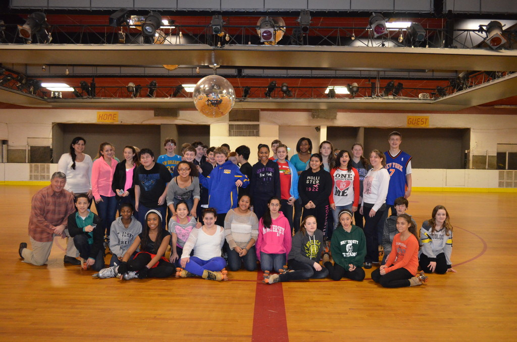 Holy Name students went to Hot Skates on Jan. 31, an annual tradition. For the eighth-grade class, above, it was their last trip there together.