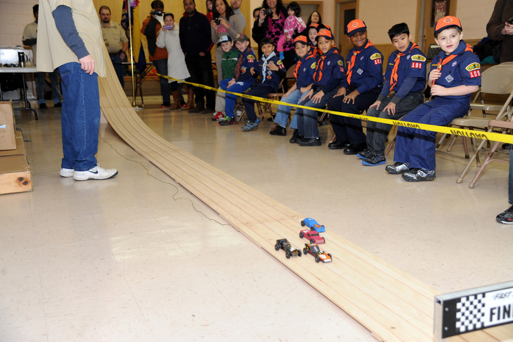 Cub Scouts from Pack 109 watched their handcrafted cars fly by on Feb. 2.