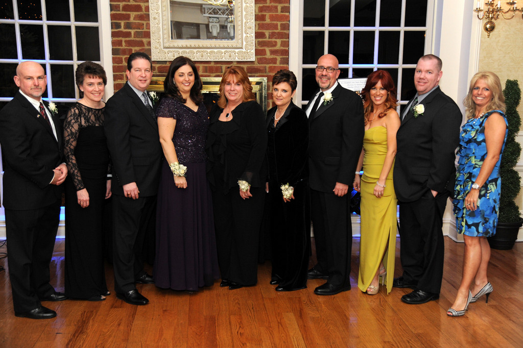 The honorees during St. Elizabeth Ann Seton's 20th year anniversary gala: From left, Richard and Jean Carlson, Glenn and Linda Gering, Kerry Kahn, Patty and Gary Smith, Michele and Joe Cain, and St. Elizabeth principal Leann Graziose.