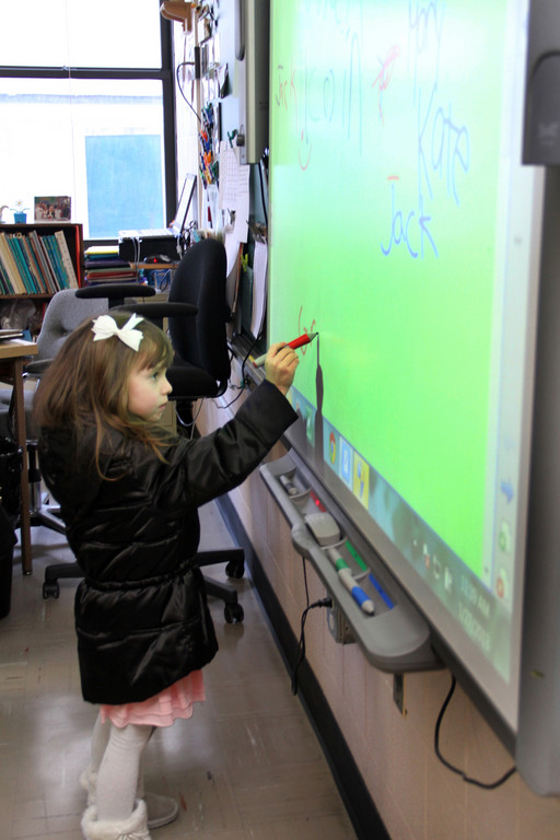 5-year old Grace Profitlich tried out the smartboard.