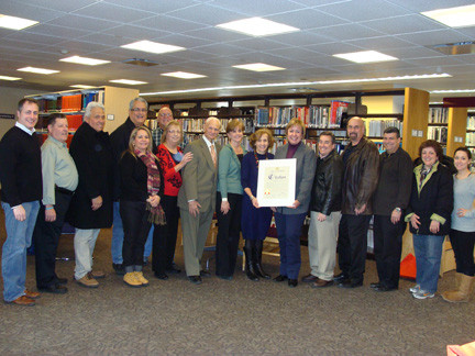 Local, town, village library officials gathered at the library's grand opening.
