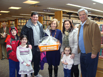 Library Director Betty Charvat, center, accepted a gift basket of books from patrons. From left were Patrick, Theresa and Rob LaBarbera, Kathleen and Francesca Sorrentino, and Sen. Dean Skelos, who stopped by to congratulate Charvat and her staff.