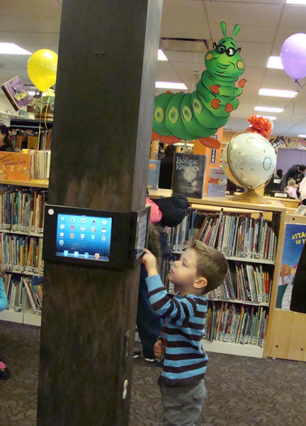 iPads are a new addition to the children's library, thanks to a technology grant from the State Senate, Nicholas Lanteri, 2, played a digital game.