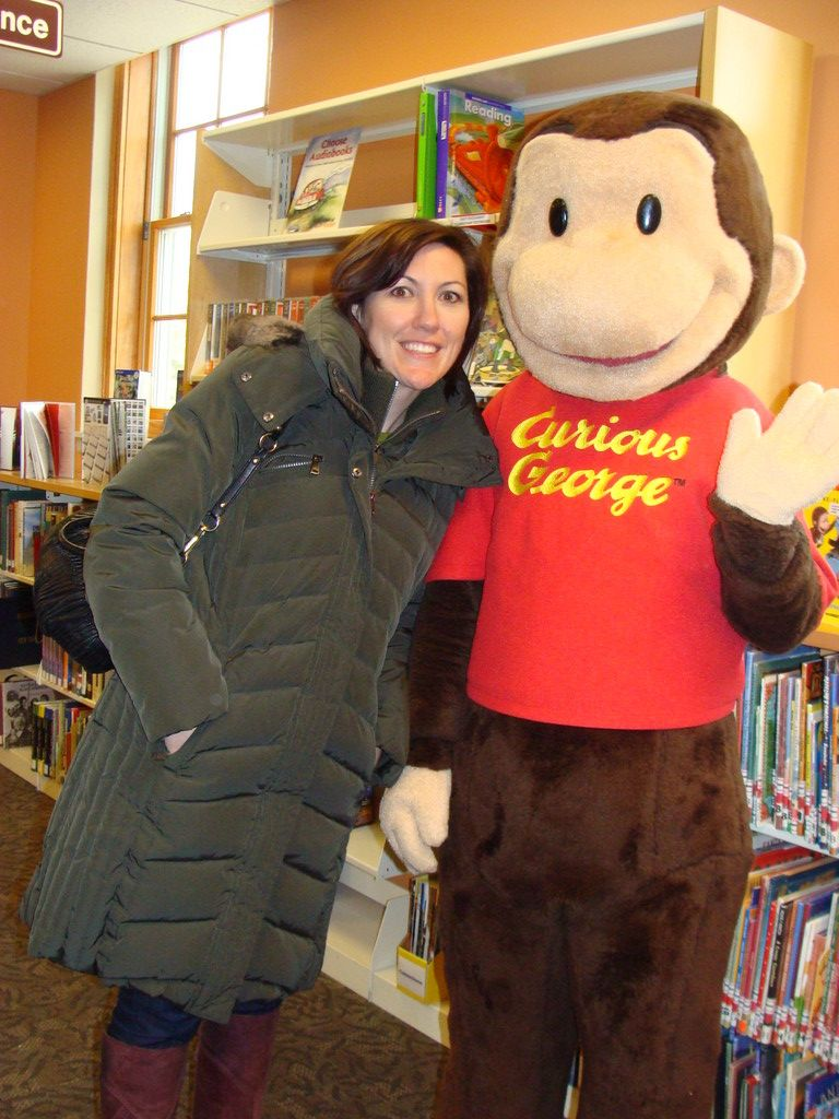 Herald's 2012 person of the year Elizabeth Daitz with a friend, Curious George.