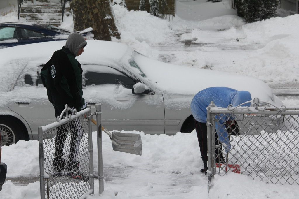 Andy and Mike help this homeowner dig out after Nemo.