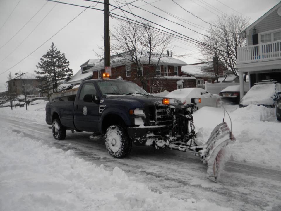 City vehicles are busy removing snow throughout Long Beach.