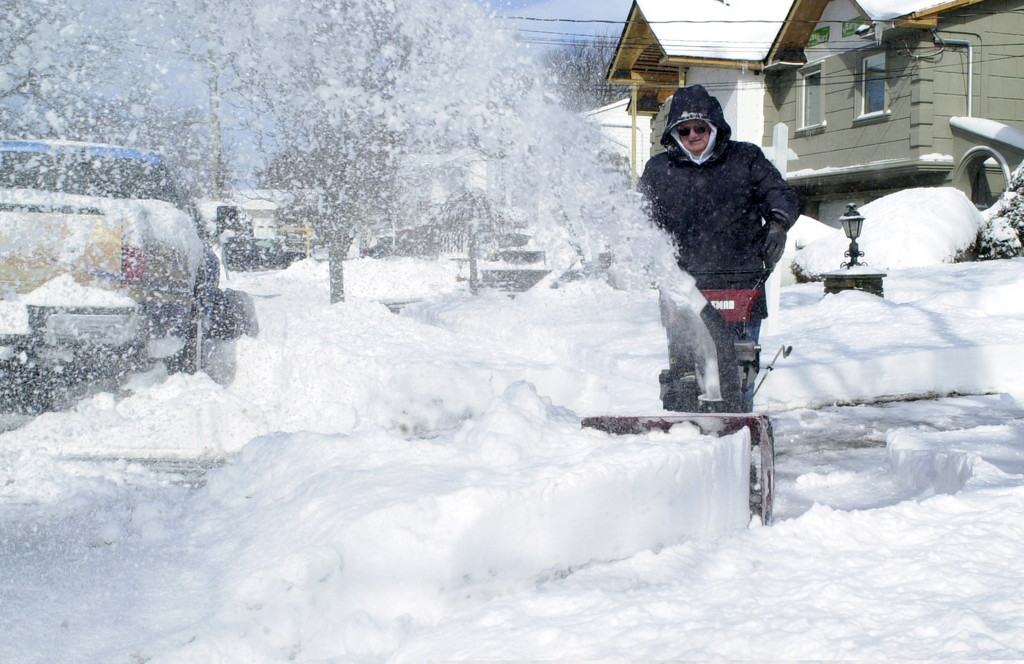Sgephan Kravitz dug out with a snow blower after snowstorm Nemo buffeted Bellmore-Merrick Friday into Saturday morning.