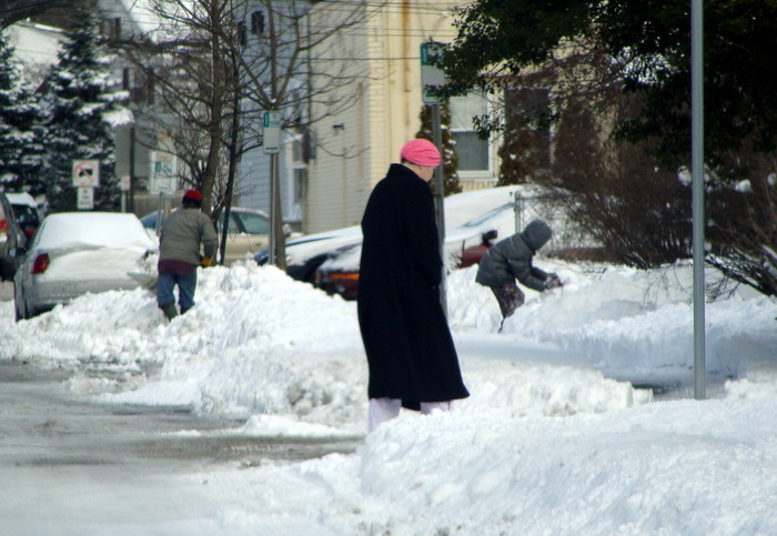 Residents work, walk and play in the snow