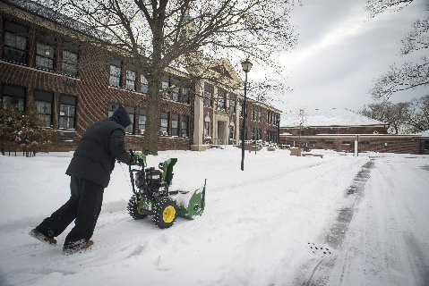 Clearing the snow at ERHS.