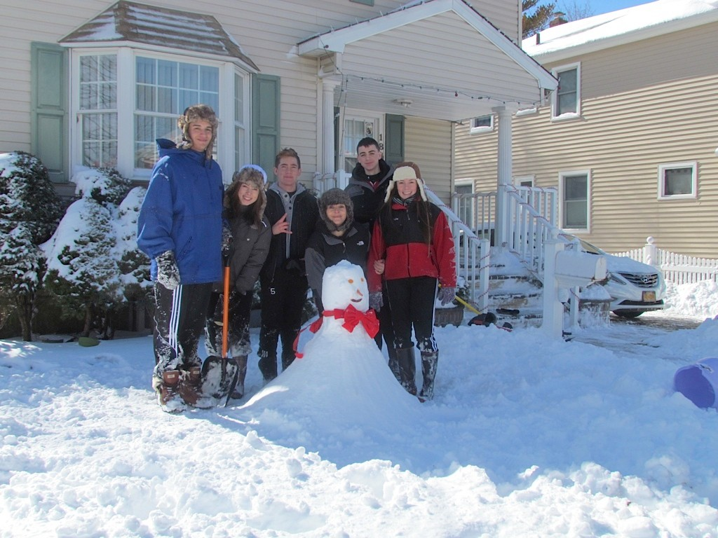 The Freire family built a snowman outside their New York Avenue home in Valley Stream on Saturday.