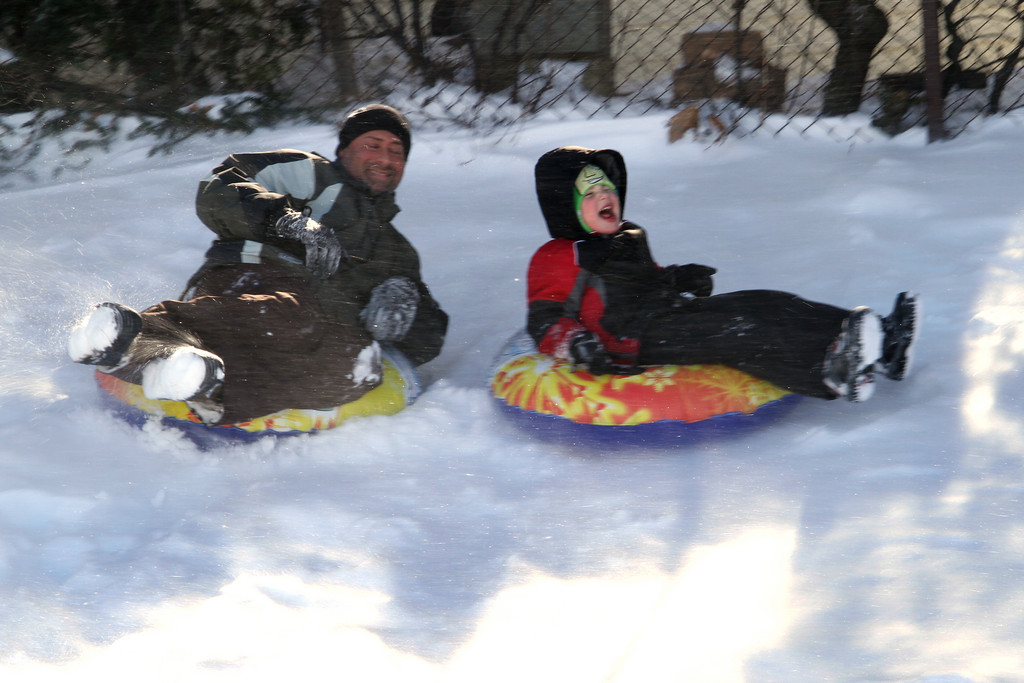 Michael and Gavin Gulino tube at James A. Dever school's parking lot.