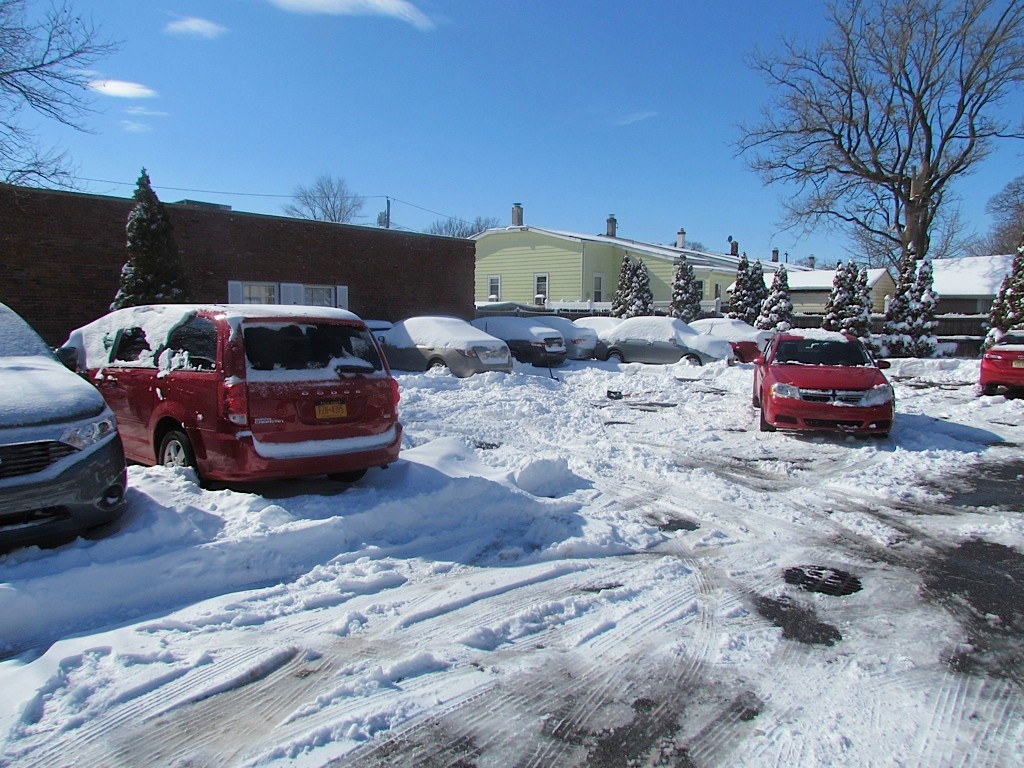 Cars made their way through the snow on Saturday in Valley Stream.