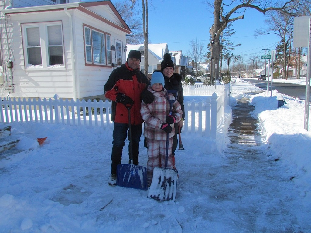 The Montanari family of East Mineola Avenue takes a break from shoveling.
