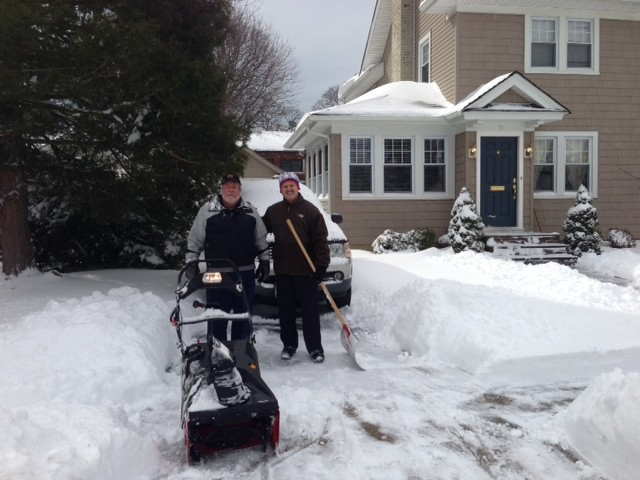 Good Samaritans Larry Fodrowski and Cliff Condon worked to clean the snow out of the driveway of a neighbor who was away.