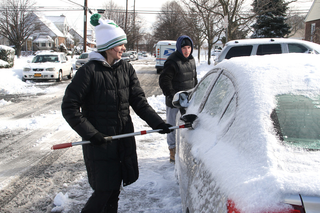 Gina Gabbamonte and Gerard Maggio team up to clean two cars.