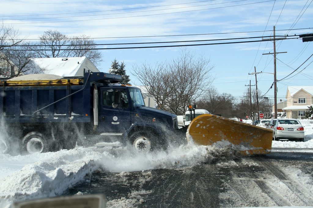 A plow crosses Benris Ave. in Franklin Square.