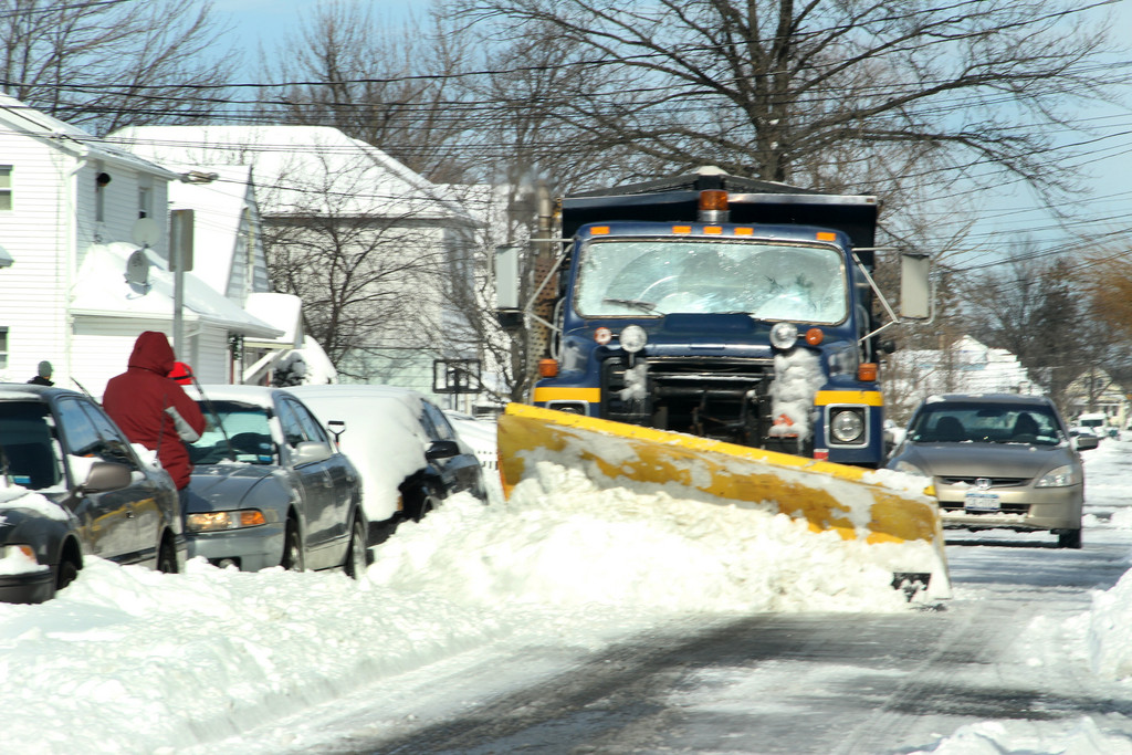 plow cleans up the streets of Elmont.