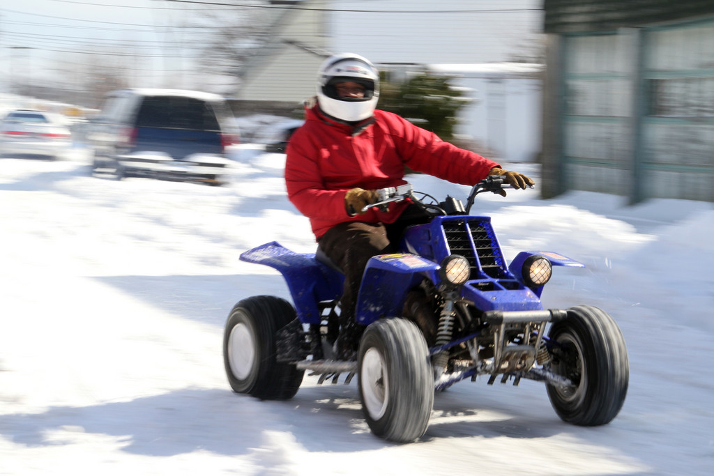 Tooling down G Street on his ATV.