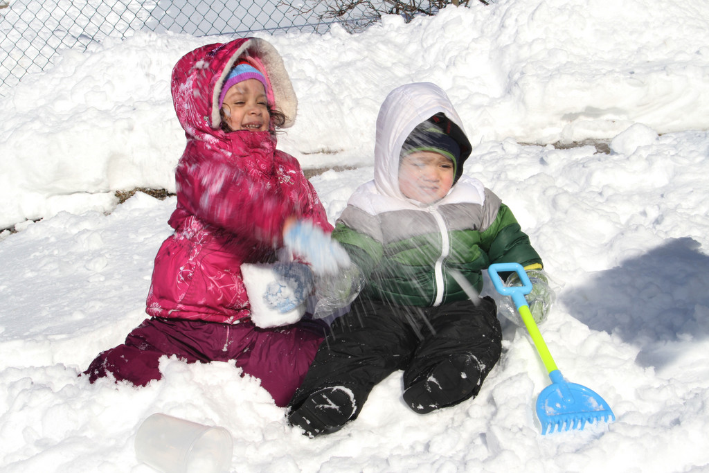Amy Martinez get some snow in her brother Jhons' face.