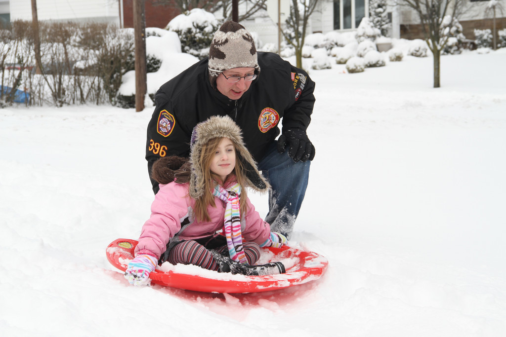 Robert Schurr gives daughter Annmarie a push to get her going.