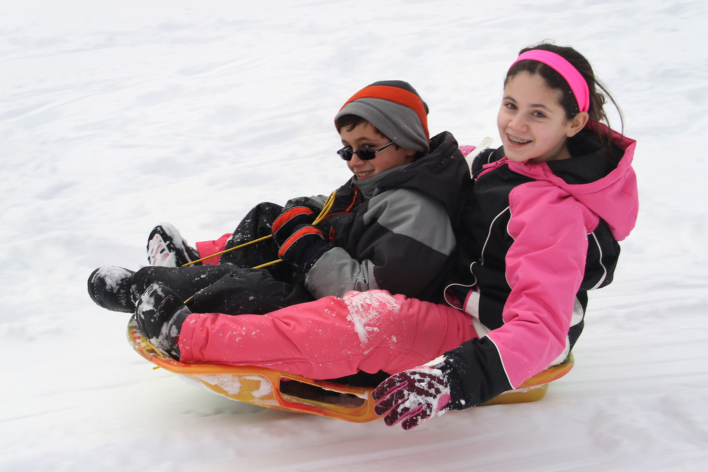 Adriana and Nicholas Marchetti ride tandem down the hills of Halls Pond Park.