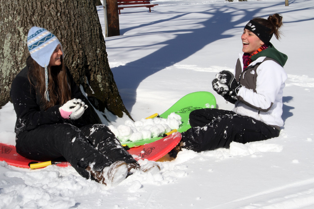 Maggie Pruyn and Lindsay Montgomery make a load of snowballs for a