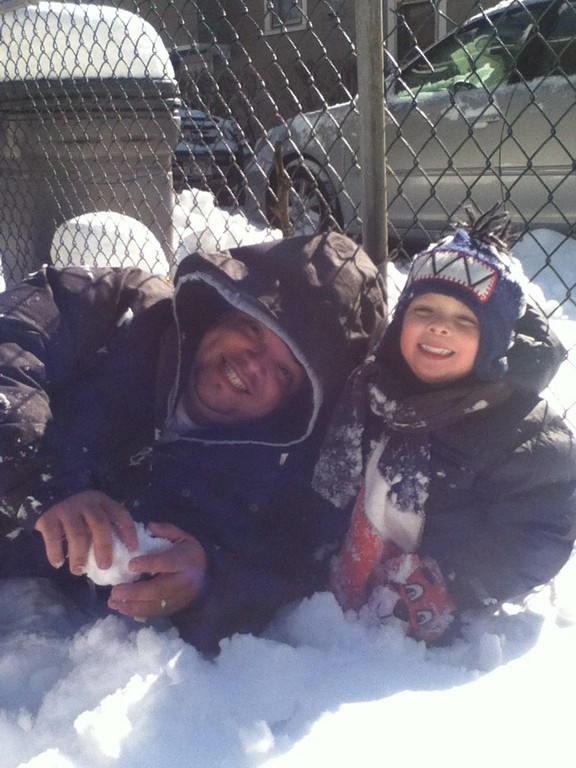Joaquin Gallardo,4 and his father, Angel, played in the snow outside their Catherine Street home.