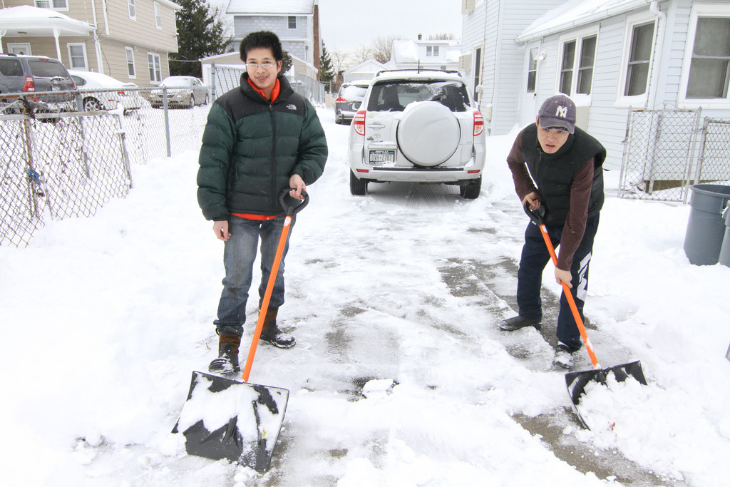 Chen Huag and Pinny Ling shoveled on  Jefferson Street in Inwood.