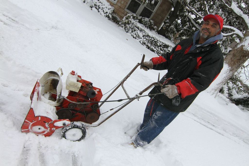 Tony Martez used a snowblower to clear snow on Jefferson Street in Inwood.