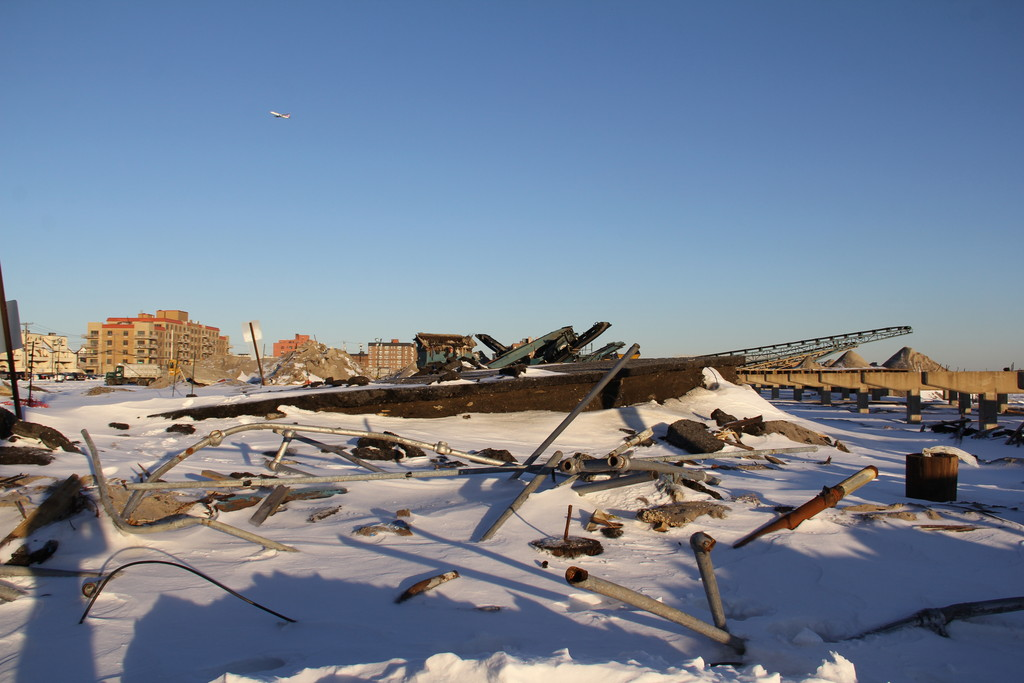 The remnants of the boardwalk covered in snow