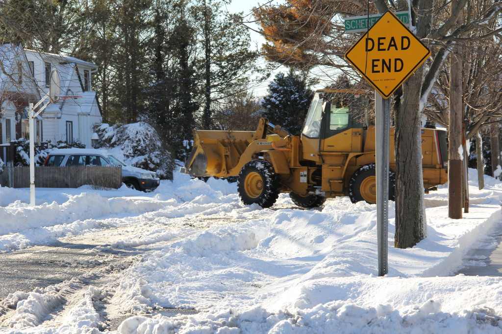 Plows worked all day to clear the streets. This one clears the dead end of Phoebe and Scherer Blvd