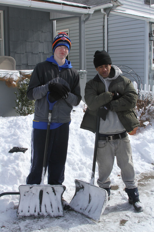 Sammy Robinson and Tristian Rodriquez shoveled the snow in  Cedarhurst.