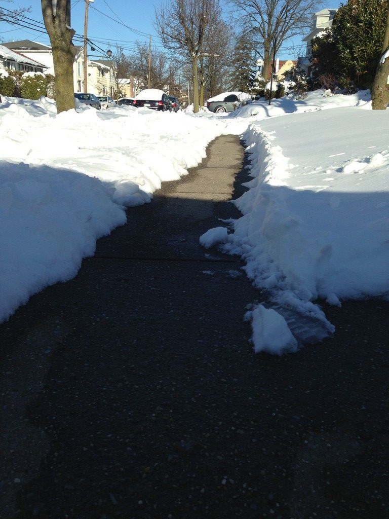 A shoveled sidewalk on Rugby Road in Cedarhurst.