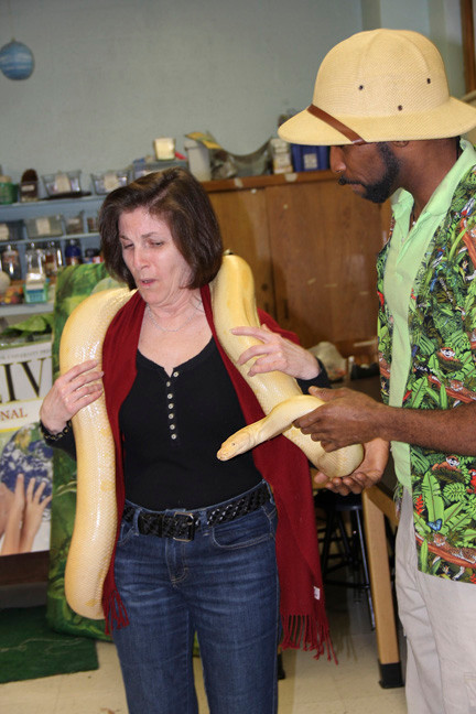 Debbie Ciavarella was not happy, but still tried on the big snake.