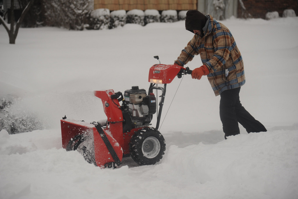 Snowblowers could be seen all over Oceanside on Saturday morning.