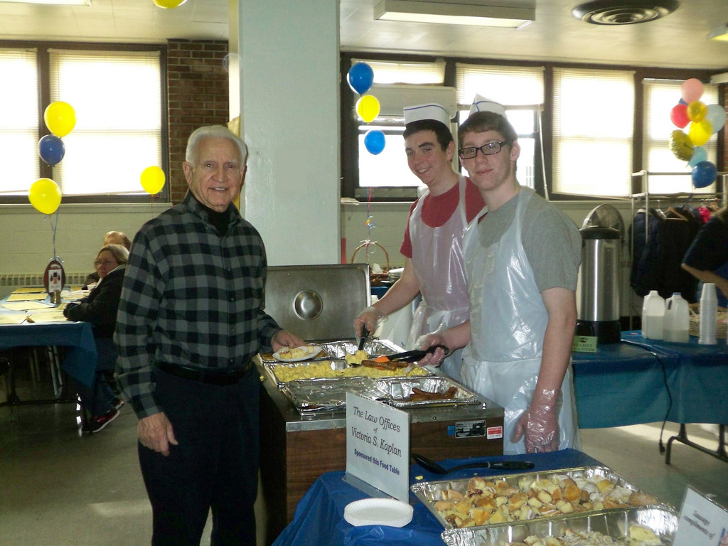 Kiwanian Fred Pomerenke (l) with breakfast servers, Brendan Fitzpatrick and Ryan Sayles.