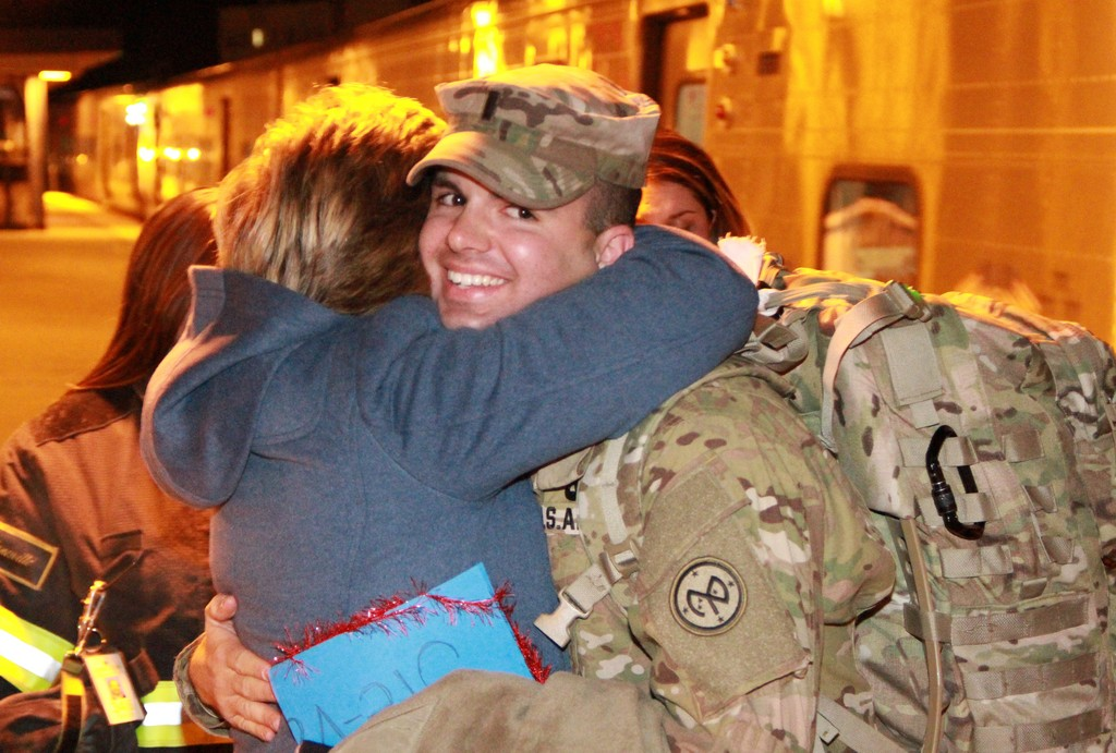 Steven Liguori got a tight hug from his mother, Liz, at the LIRR station in Lynbrook upon his arrival from Fort Dix in New Jersey.