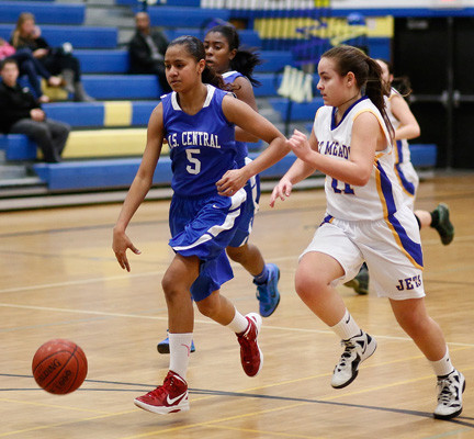 Valley Stream Central's Naomi Bolasingh, left, who scored 19 points, had a step on East Meadow's Crista SanAntonio during last Monday's game.